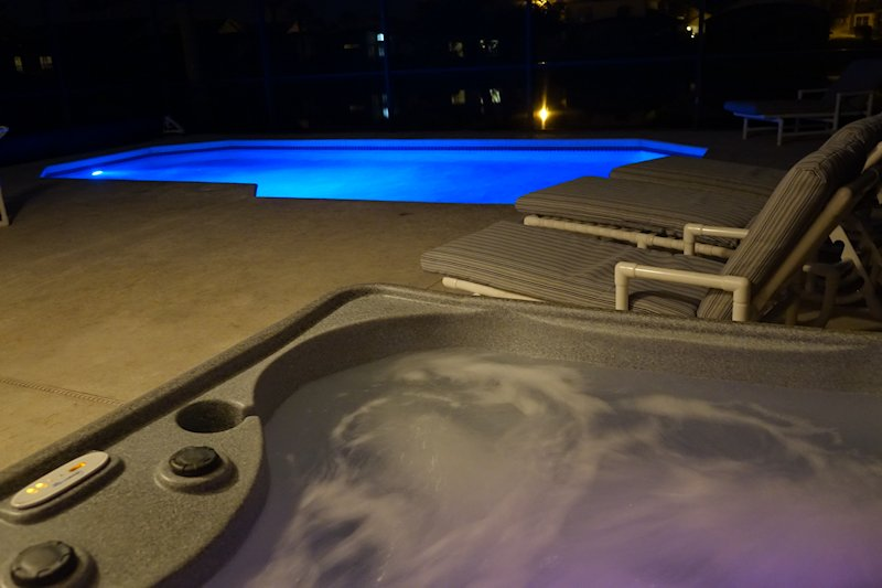 Hot tub and pool by night