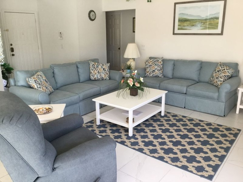 Spacious warm and welcoming open plan sitting room