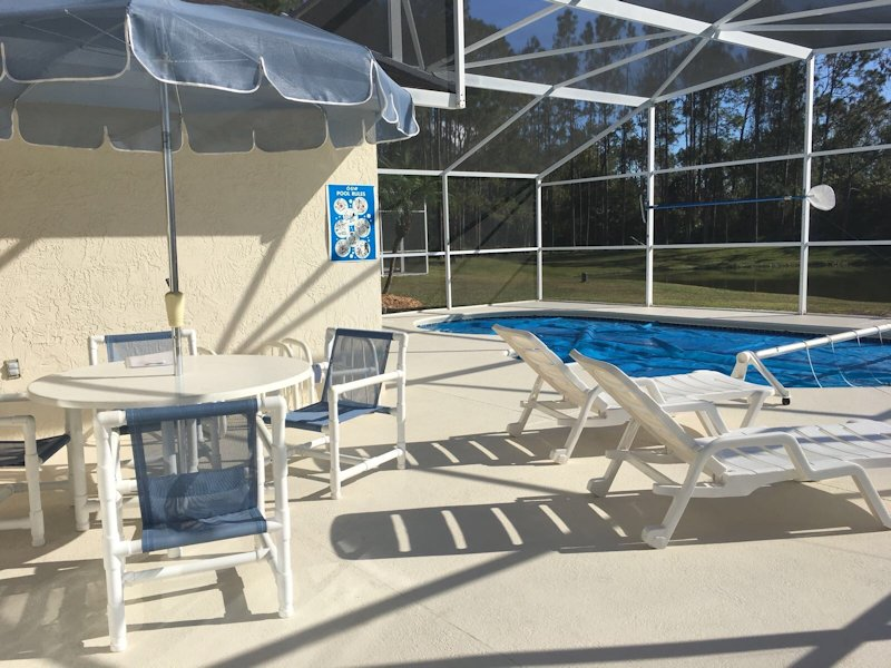 Large pool deck area with dining area