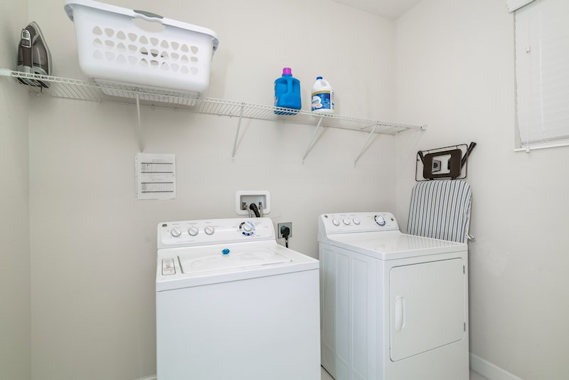 Laundry room with large washer and dryer