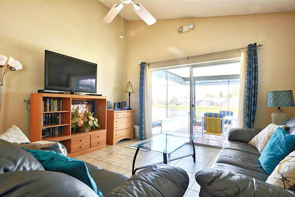 Family room with large screen TV overlooking the lake