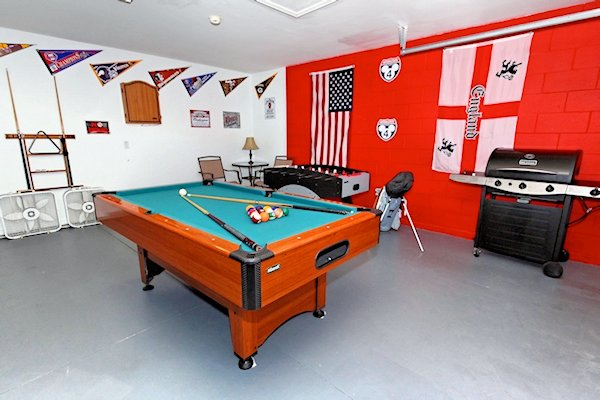 Games room consisting of pool table air hockey and table soc